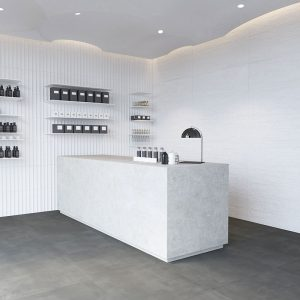 1 ESSENTIAL Concret White 12x24 ceramic wall tile QDI Surfaces product room scene 800x800 1
